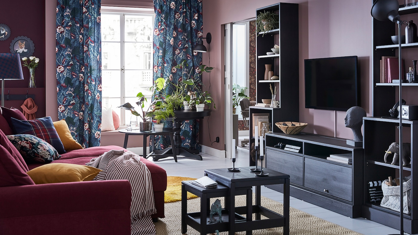 IKEA GRÖNLID dark red 4-seater sofa and HAVSTA dark brown TV bench in a dark pink walled living room setting.