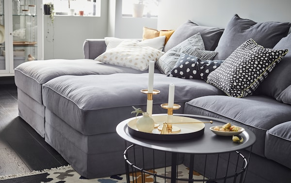 IKEA GRÖNLID large grey cotton sofa with two long chaises and decorative black and white dotted cushions.
