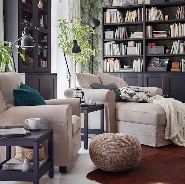 IKEA GRÖNLID soft beige armchair and long chaise in a living room setting with SANDARED beige pouffe.