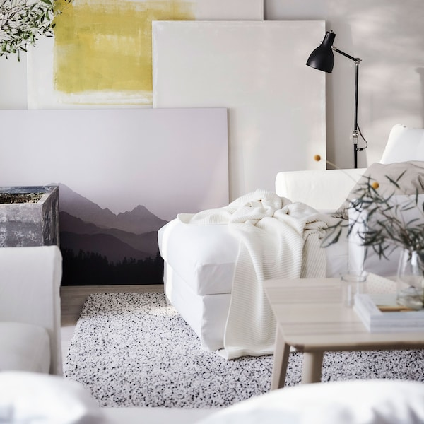 IKEA GRÖNLID soft white cotton chaise lounge in a living room setting.