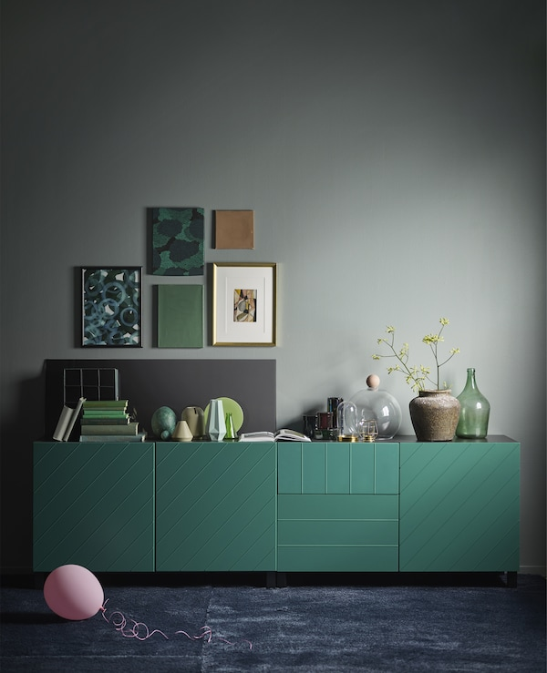 IKEA has a variety of green cabinets like BESTÅ storage combination in blue-green. The modern, rectangular cabinet has a black-brown frame, two soft-closing drawers and a push-open door.