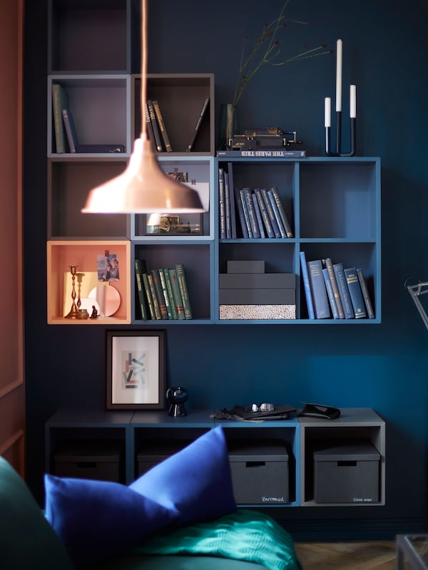 IKEA has a variety of open cabinets for wall storage like EKET cabinets. You can group the square cabinets how you want.