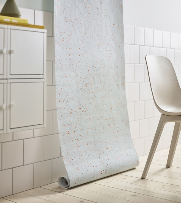 IKEA has a variety of Scandinavian home decor. Even a simple, light blue and orange dotted pattern on gift wrap like ÖVERFLÖD can make a stylish statement. Just hang it on the wall for an instant pop.