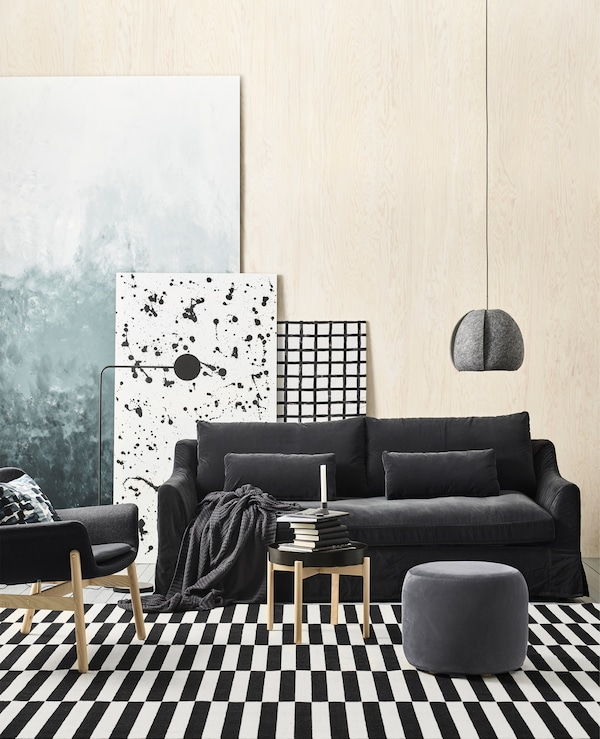 IKEA has furniture for a black and white living room like a big, black-and-white-striped rug and FÄRLÖV dark grey sofa. The sofa has a velvety cover and rounded armrests with lots of comfort from pocket springs.