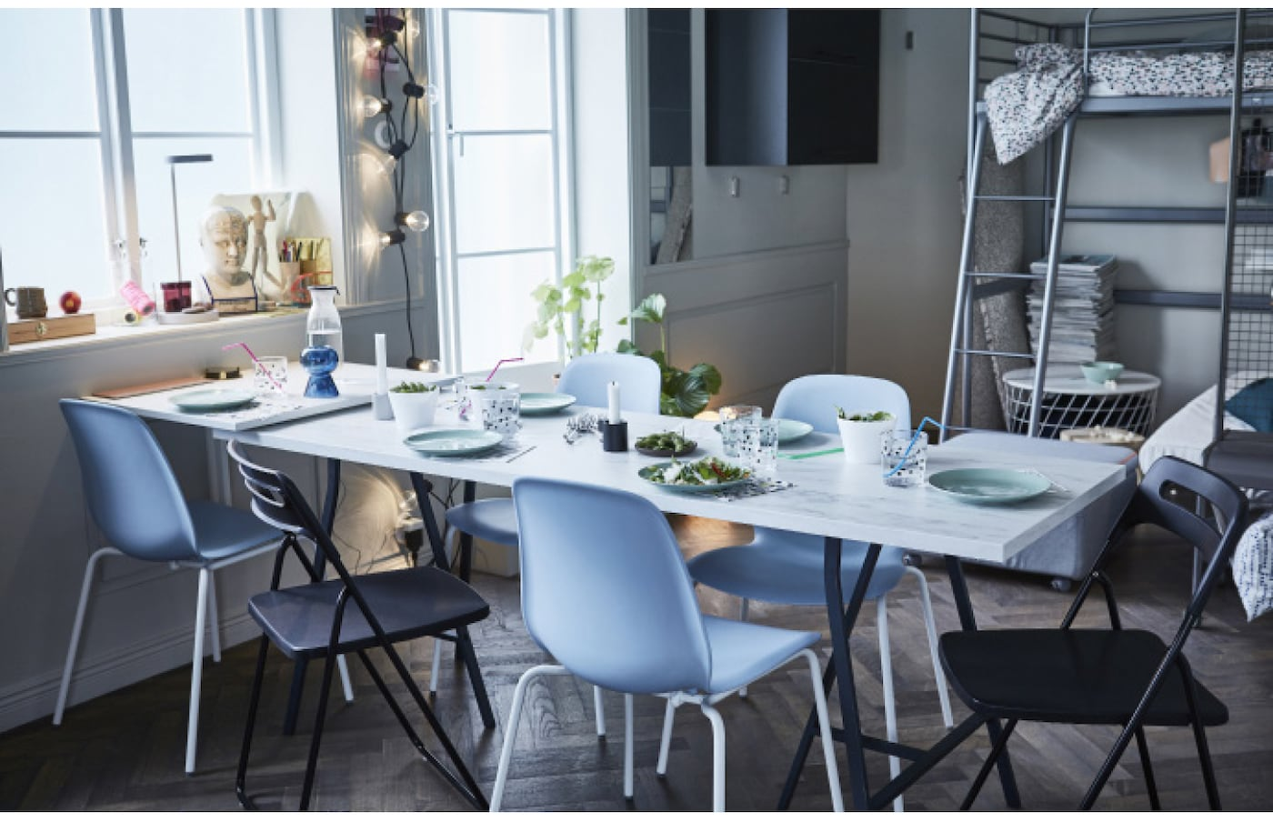 IKEA has furniture for small spaces like EKBACKEN work top with white marble effect. Use it against a wall as art most of the time. When you have guests over for dinner, put it on trestles for a pop-up table. Add foldable chairs and enjoy the company!