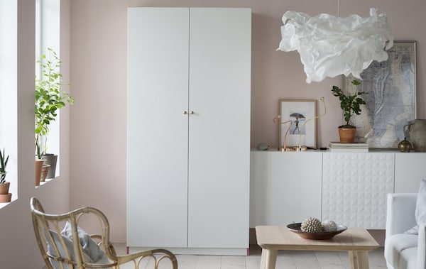 IKEA has lots of easy and helpful family room ideas like making an open-close toy storage solution. It keeps toy clutter behind two closed doors of PAX wardrobe in tanem white, so the room feels calm and inviting to grown ups, too.