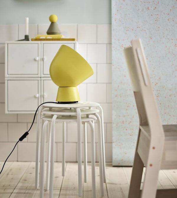 IKEA has lots of modern dining room furniture like MARIUS white plastic and coated steel. It's stackable and lightweight with a circular top on thin, strong legs.