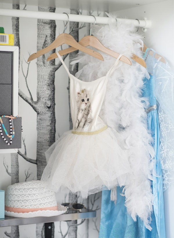 IKEA has toy storage ideas like transforming the inside of an old wardrobe into a toy box. Use KOMPLEMENT clothes rail in white to make hanging space for fancy dress outfits your child can wear during a dramatically creative performance.