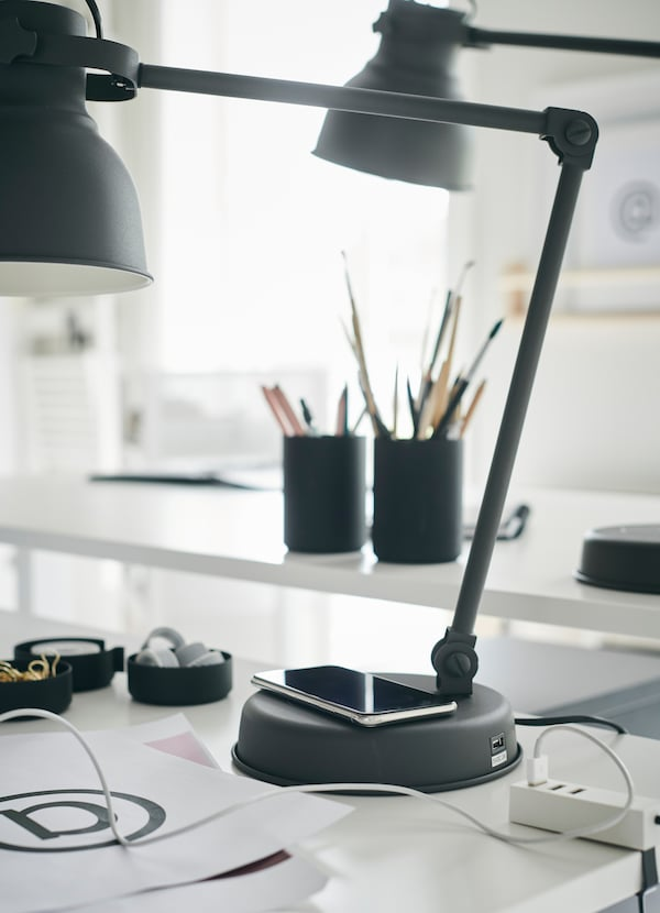 IKEA HEKTAR dark grey wireless charger work lamp provides directed task light and a place to recharge your phone. Place it at the base, or in its USB port.