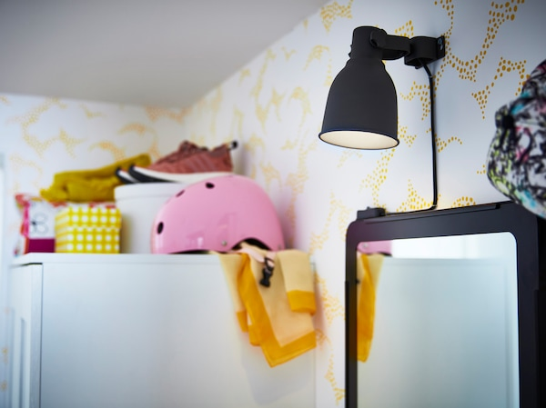 IKEA HEKTAR wall clamp spotlight is an adjustable lamp coated in a modern dark grey colour. Turn the lamphead up and down to direct the light source.