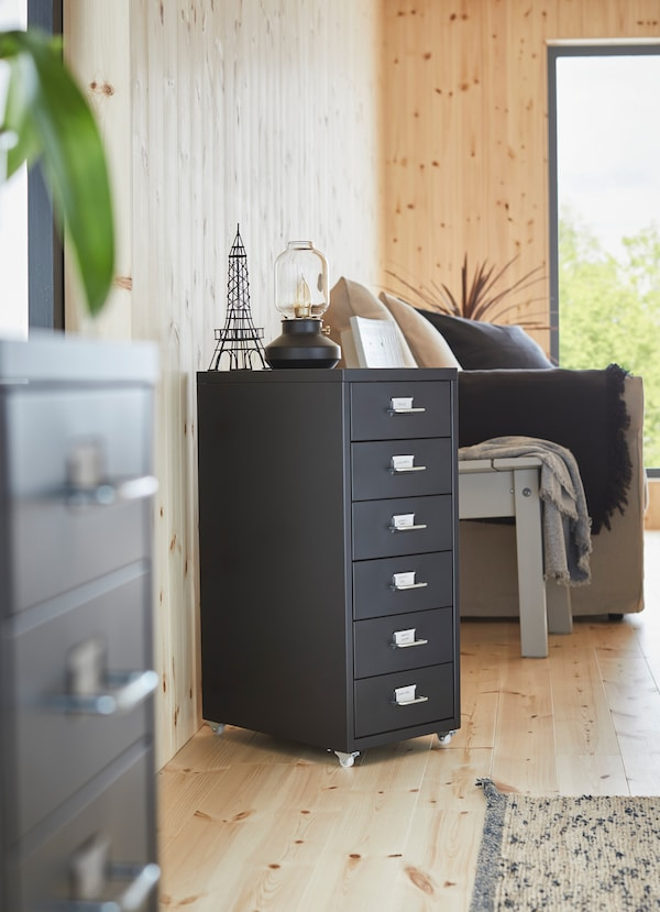 IKEA HELMER black portable drawer unit on castor wheels with 6 drawers.