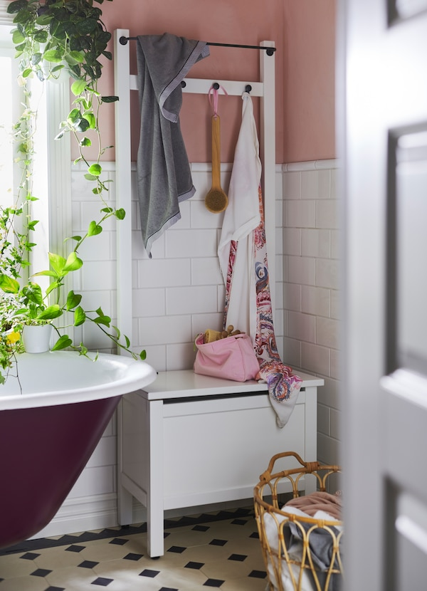 IKEA HEMNES white shelving unit is made of solid wood and sturdy to sit on since it has a bench with a deep storage compartment. Hang  towels on the 4 hooks provided, or on the built-in rail.