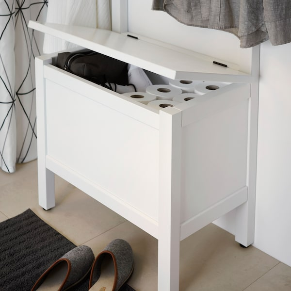 IKEA HEMNES white storage bench fits in many small space bathrooms. The towel rail lets you hang clothes and towels, while the storage bench is also a seat.