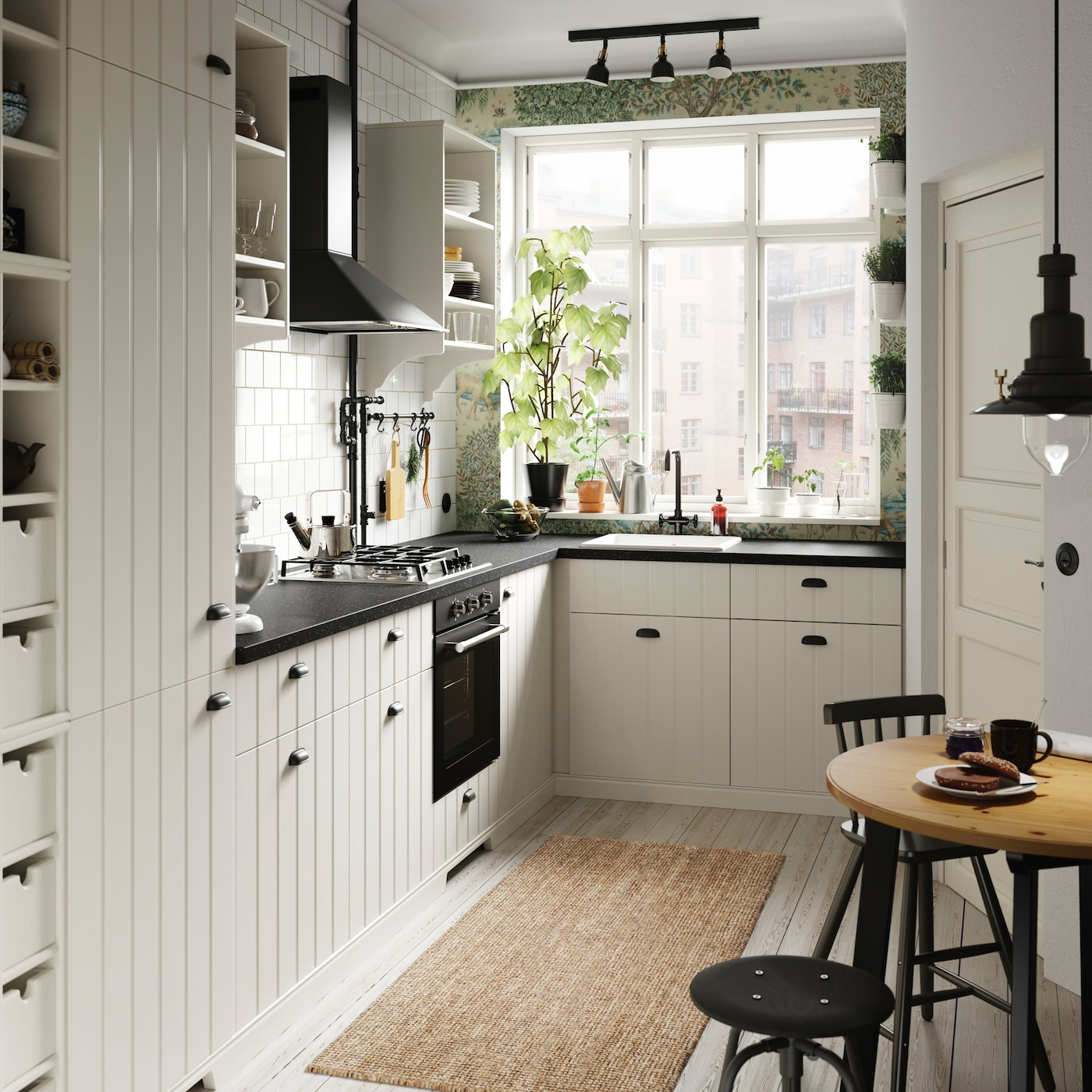 IKEA HITTARP white slatted kitchen door fronts with slats bring a country farmhouse style to this small kitchen.