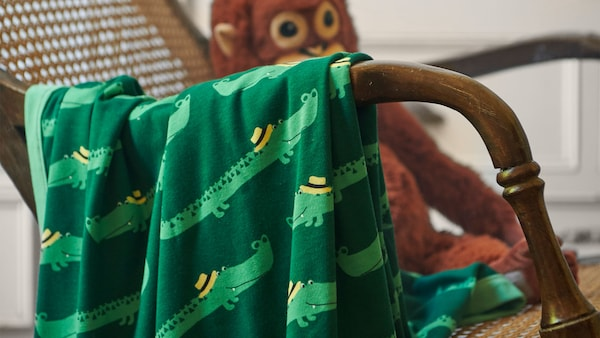 IKEA Home Furnishings, featuring children's textiles such as the the soft RÖRANDE Blanket, crocodile, green