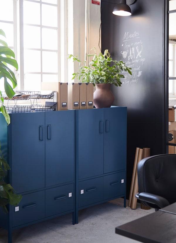 IKEA IDÅSEN dark blue cabients with two drawers below on each unit.