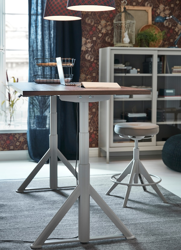IKEA IDÅSEN white sit stand desk with smooth wood tabletop is adjustable to stand at the right height for you and the whole family.