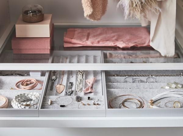 IKEA KOMPLEMENT felt organisers storing necklaces, bracelets and jewellery.