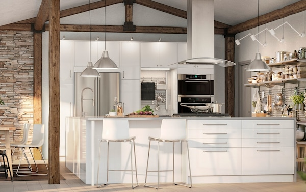 IKEA KUNGSFORS stainless steel storage racks and rungs as an open pantry in an white open plan kitchen.