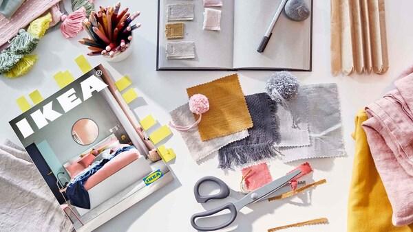 IKEA-kuvasto ja askartelutuotteita pöydällä