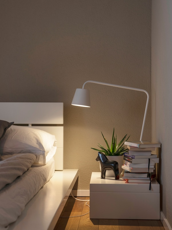 IKEA lamp on the bedside table.