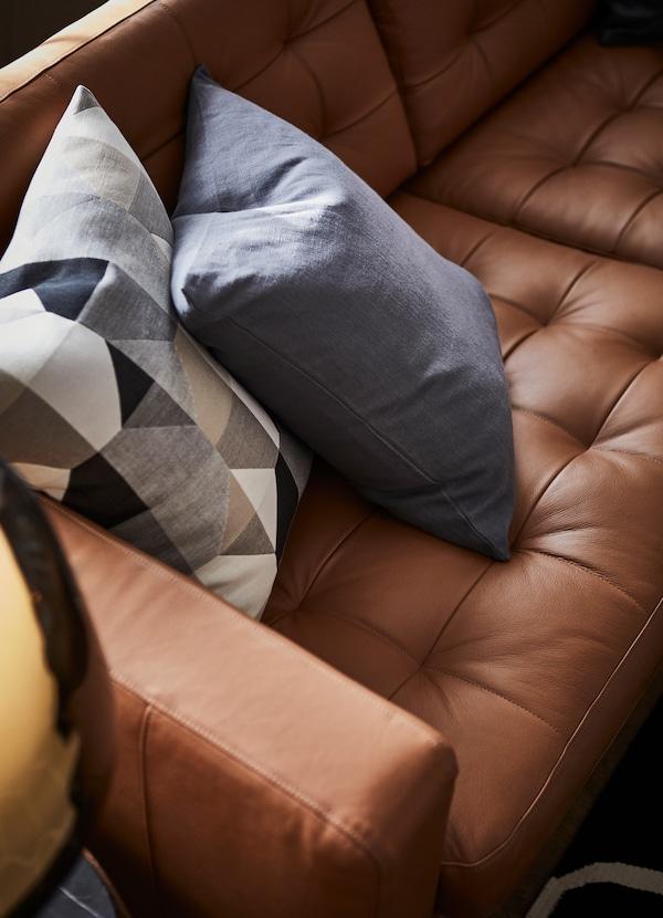 IKEA LANDSKRONA brown leather sofa seats.