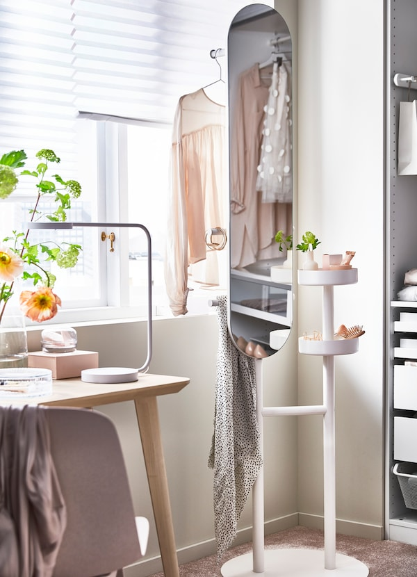 IKEA LIERSKOGEN standing valet mirror with two white circular dishes for storing accessories.