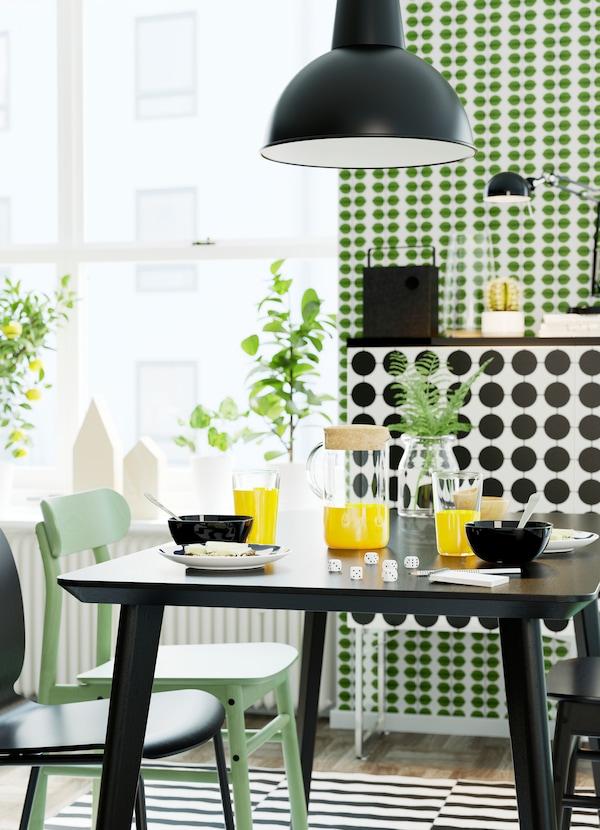 IKEA LISABO light ash veneer dining table, green and RÖNNINGE chairs and SVENBERTIL black chairs.