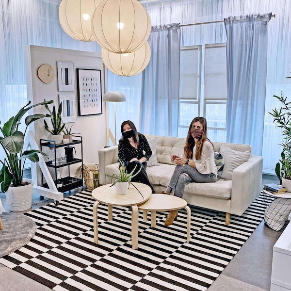 IKEA Live hosts on a sofa in a living room setting