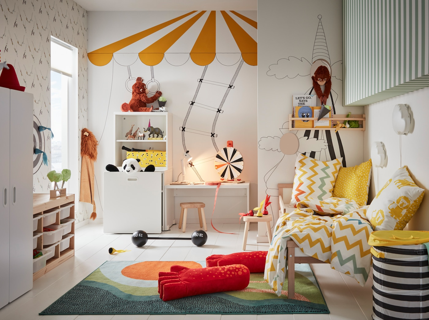 IKEA LUSTIG toy series and boardgames in a circus-themed children's bedroom.