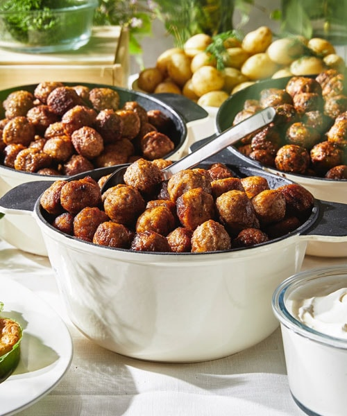 IKEA meatballs in various pots on a table.