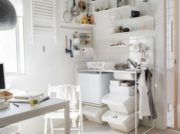 IKEA MELLTORP white table and SUNNERSTA mini-kitchen range complete this small white-styled kitchenette.