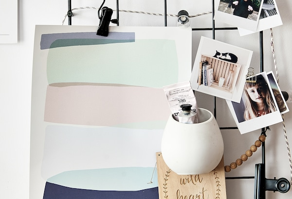 IKEA memo board with photos, posters and jars with clips