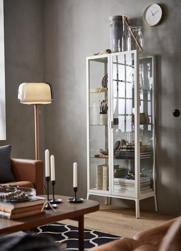 IKEA MILSBO glass cabinet with a white frame.