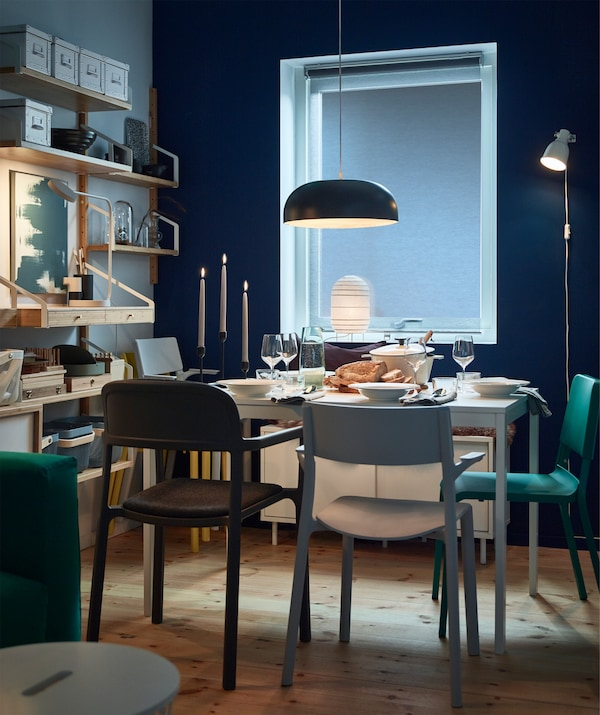IKEA NYMÅNE black steel pendant lamp and STORUMAN white paper lantern make soothing mood lights at dinner time. Use an LED dimmer to adjust the overhead lighting with a click.