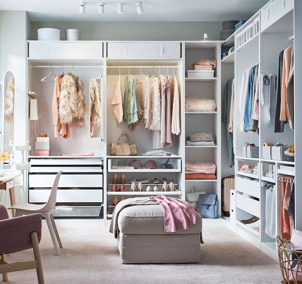 IKEA PAX wardrobe system and KOMPLEMENT storage system work together to create this dream walk-in closet.