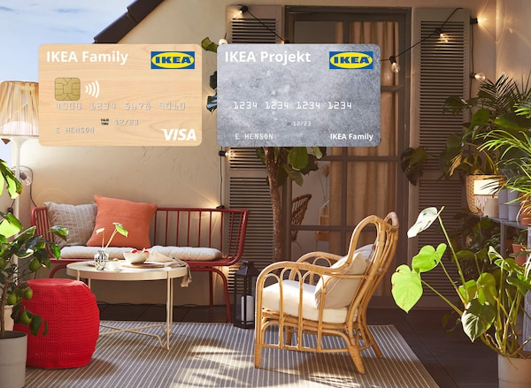 IKEA® Visa and Projekt credit cards featured in an outdoor space with chairs, a table and plants