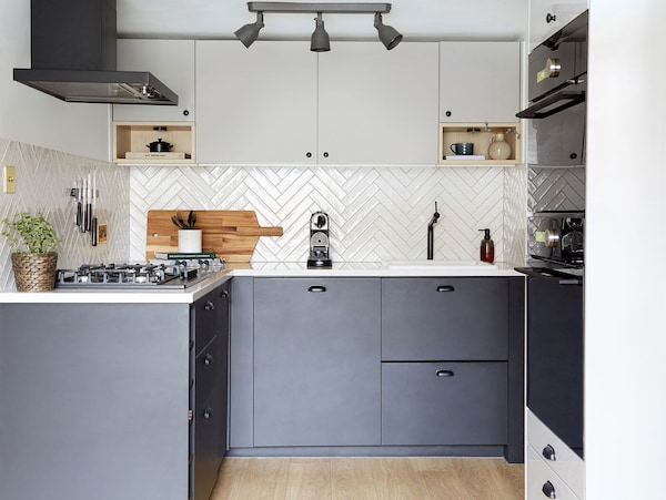 IKEA RINGHULT two-tone modern L-shaped kitchenin black and grey.