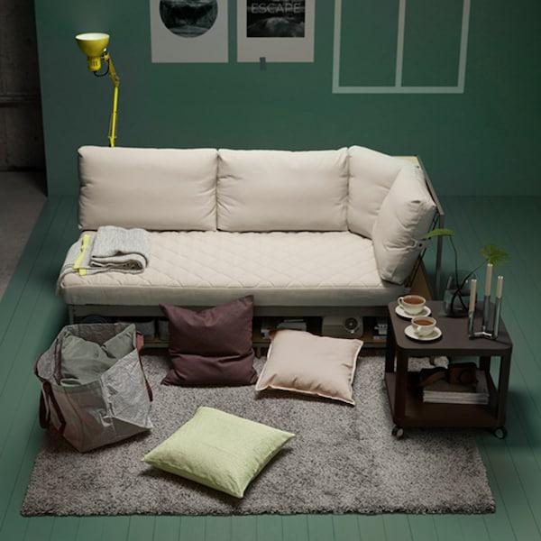 IKEA SANELA grey-green cushion covers on a rug in a living room