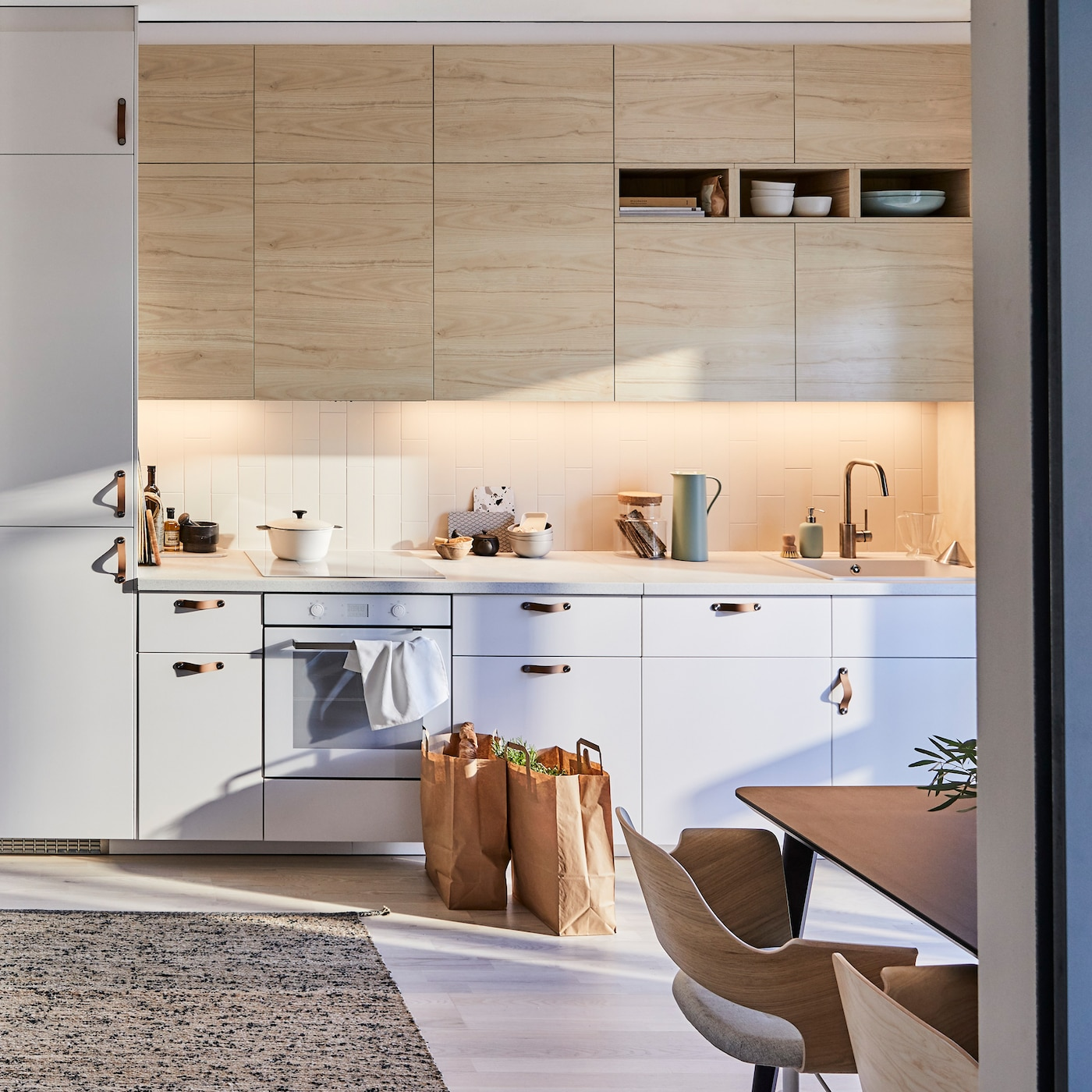 IKEA SEKTION kitchen with light wood ASKERSUND ash effect door fronts pair well with a MELHOLT flatwoven rug woven from jute and wool for a zen kitchen.