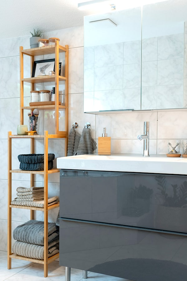 IKEA shelving unit in the bathroom provides lots of storage space for IKEA towels and other accessories.