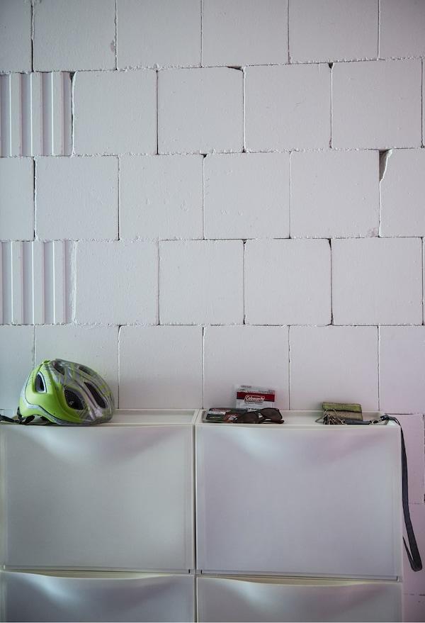 IKEA shoe cabinets on a white wall.