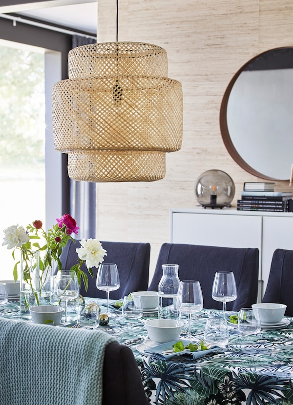 IKEA SINNERLIG pendant lamp is weaved from sturdy bamboo fibers to create an intricate cross pattern on its dome shape. Make a bold dining room statement!