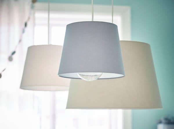 IKEA SINNRIK lamps with plastic bulb protectors.