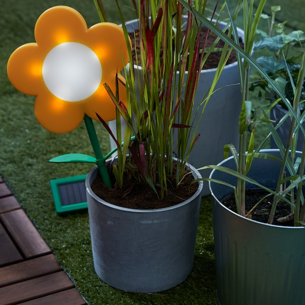 IKEA SOLVINDEN LED plastic solar-powered light stick in a potted plant.