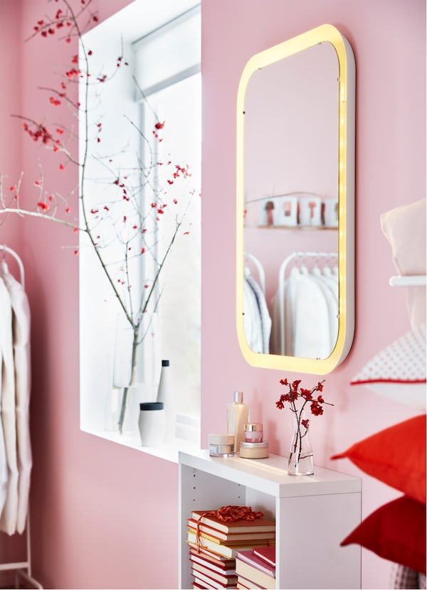 IKEA STORJORM white mirror with integrated lighting.