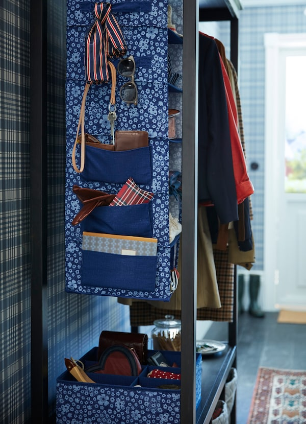 IKEA STORSTABBE hanging storage unit and boxes come in a blue white floral pattern in polyester fabric. The side has extra pockets to hold more items.