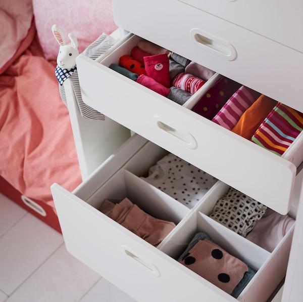 IKEA STUVA FRITIDS white chest of drawers with RASSLA white storage organiser compartments.