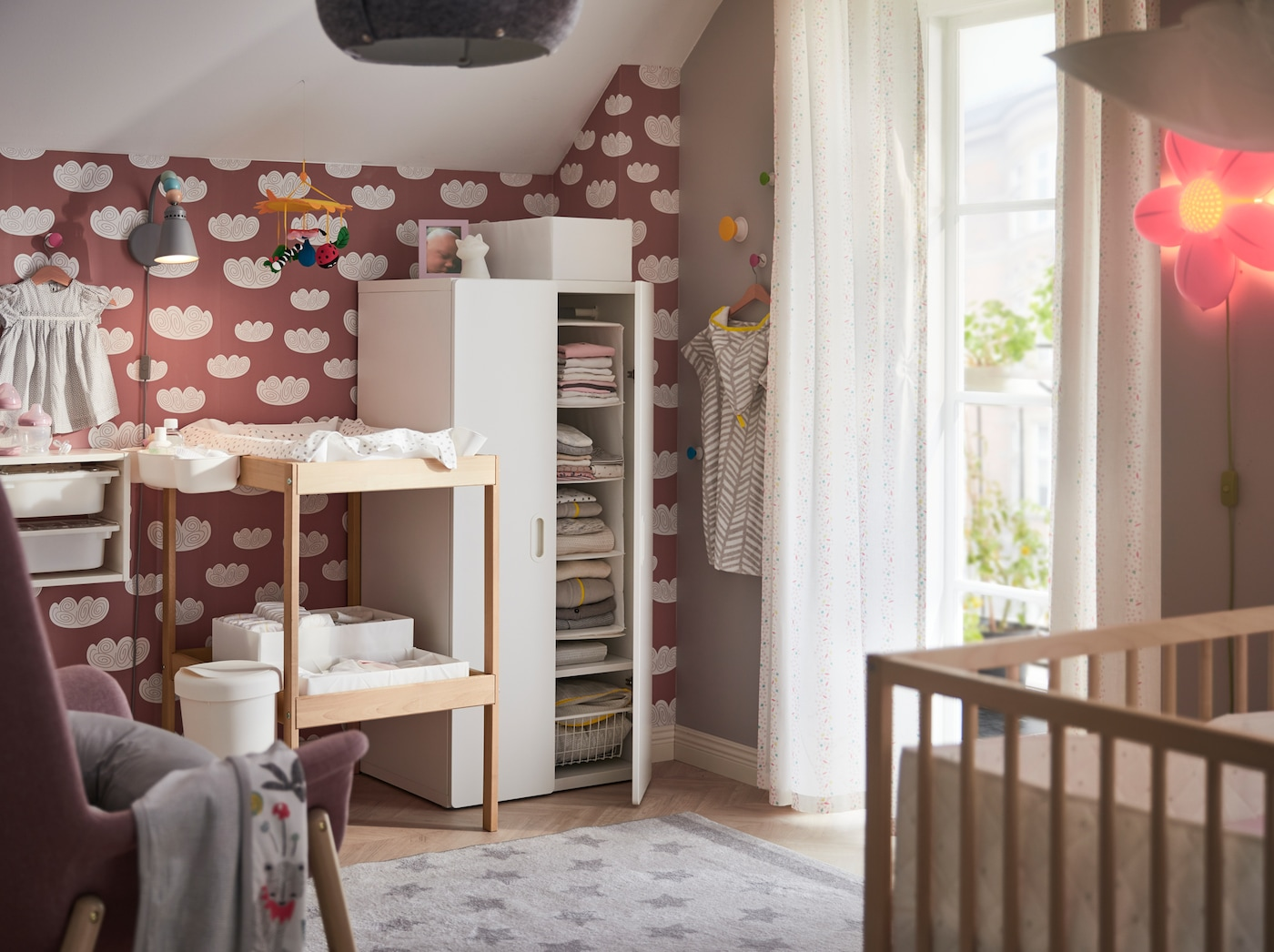 IKEA STUVA FRITIDS white clothes wardrobe and SNIGLAR beech and white changing table in a nursery.