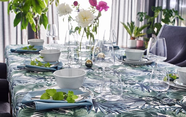 IKEA TORGERD fabric has a graphic palm patterned design. Make a tropical tablecloth! Pair with clear glass CYLINDER vases and KRUSTAD white ceramic dishes.